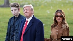 U.S. President Donald Trump walks with son Barron and first lady Melania Trumpม November 26, 2019.