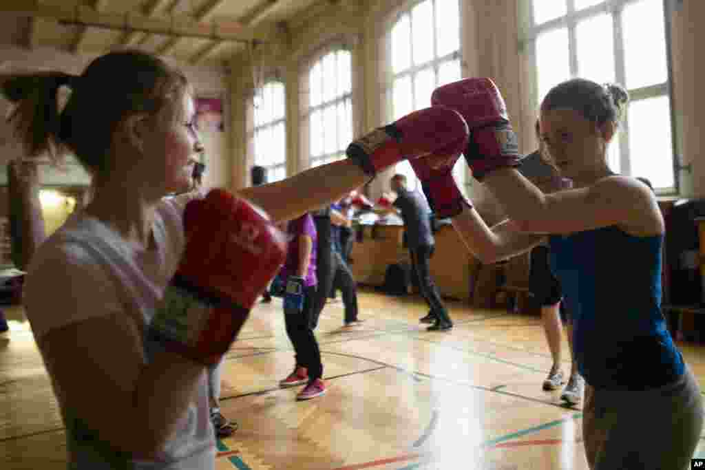 Two women attend a boxing workshop of the Boxgirls Berlin to mark the International Womens Day,Berlin, Germany, March 8, 2013.