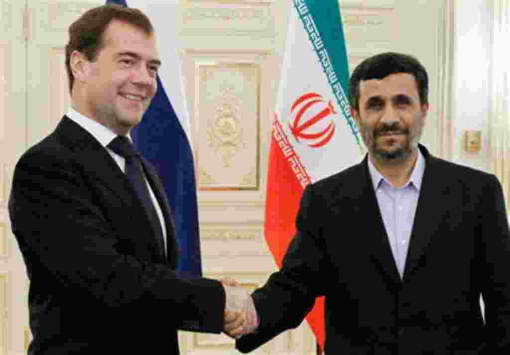 Russian President Dmitry Medvedev, left, and Iranian President Mahmoud Ahmadinejad shake hands during their meeting at the sidelines of the Caspian summit in Baku, Azerbaijan, Thursday, Nov. 18, 2010. (AP Photo/RIA Novosti, Dmitry Astakhov, Presidential P