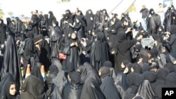 Demonstrators gather near the Pearl Monument on a main square in Manama, Bahrain, February 15, 2011