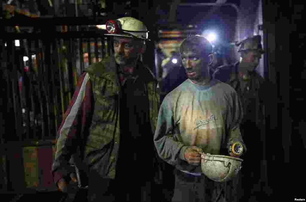 An injured coal miner leaves after he was trapped inside the Raspotocje coal mine in Zenica, Bosnia. Thirty-four Bosnian coal miners were trapped half a kilometer underground after an earthquake triggered a rock burst, leaving rescue teams struggling to clear debris to reach them.