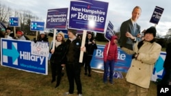 FILE - Supporters for Hillary Clinton, Bernie Sanders and Martin O'Malley rally outside the Dec. 19 Democratic presidential debate in Manchester, N.H.