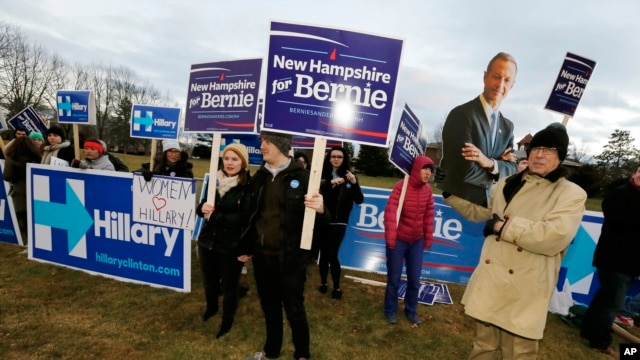 Supporters for Hillary Clinton, Bernie Sanders and Martin O'Malley rally outside the debate hall before the Dec. 19 Democratic presidential debate at Saint Anselm College in Manchester, N.H.