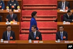 Newly-named Chinese vice Premier Liu Yandong walks past top leaders, including (front row from left to right), National People's Congress chairman Zhang Dejiang and Chinese President Xi Jinping, in Beijing's Great Hall of the People, China, March 16, 2013.
