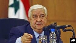 ທ່ານ Walid al-Moualem ລັດຖະມົນຕີຕ່າງປະເທດຊີເຣຍ ກ່າວຕໍ່ກອງປະຊຸມນັກຂ່າວທີ່ກຸງດາມັສກັສ, ຊີເຣຍ. ວັນທີ 24, ມັງກອນ 2012.