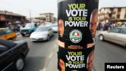 Election posters along a road on the last day of voter registration exercises in Nigeria's commercial capital, Lagos, Feb. 5, 2011 file photo.