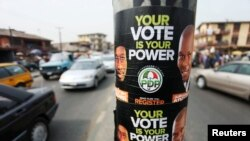 FILE- Election posters along a road on the last day of voter registration exercises in Nigeria's commercial capital, Lagos, Feb. 5, 2011.