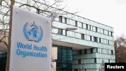 FILE PHOTO: A logo is pictured outside a building of the World Health Organization during an executive board meeting on update on the coronavirus outbreak, in Geneva, Feb. 6, 2020.