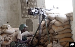 Un soldat de l'AMISOM en position de combat dans le sud de Mogadiscio, le 14 février 2012