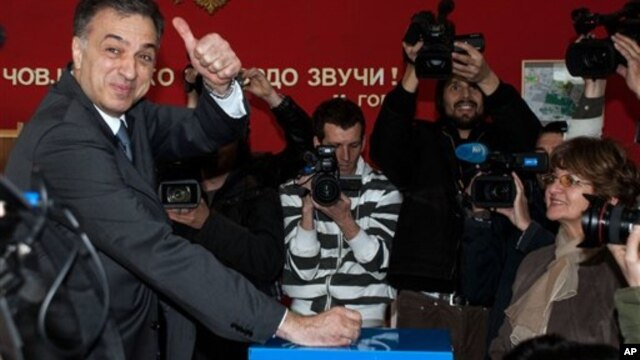 Presidential candidate and Montenegrin President Filip Vujanovic casts ballot at polling station in Podgorica, April 7, 2013.