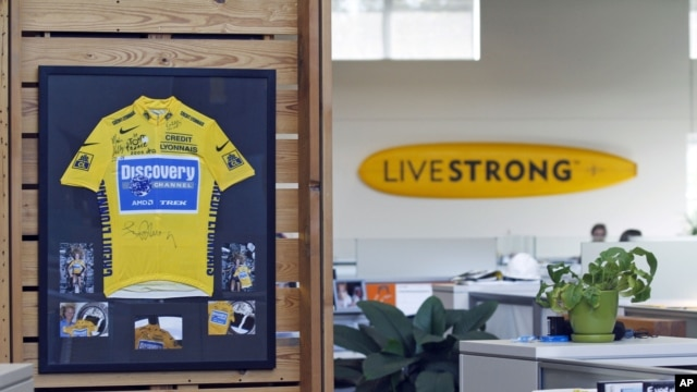 An autographed cycling jersey hangs in the offices of Livestrong, Lance Armstrong's cancer-fighting charity, October 17, 2012, in Austin, Texas.