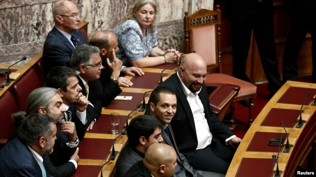 FILE - lawmakers of the extreme-right Golden Dawn party are seen in parliament in Athens October 7, 2013.