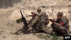 FILE - An image from a video made available on the official website of the Azerbaijani Defense Ministry on Sept. 28, 2020, allegedly shows Azeri troops conducting a combat operation during clashes between Armenian separatists and Azerbaijan in Nagorno-Karabakh.