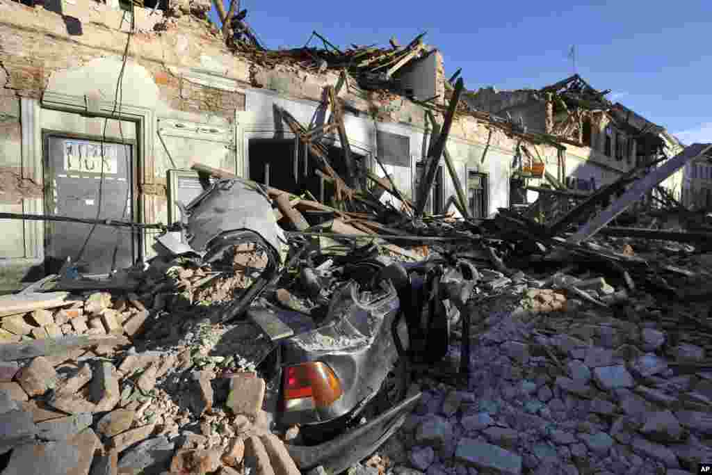 A view of a damaged car and buildings are seen after an earthquake in Petrinja, Croatia. The European Mediterranean Seismological Center says the magnitude 6.3 earthquake hit southeast of Zagreb, killing at least six people and injuring dozens.