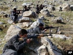 FILE -Recruits of PEJAK, the Party for a Free Life in Kurdistan, a splinter group of the PKK, the Kurdistan Workers Party, take defensive positions near the PEJAK training camp in the Qandil mountain range, northern Iraq.