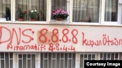 "A photo posted on Twitter apparently shows a Google DNS server spray painted into a building in Turkey. (Via <a href=""https://twitter.com/gulayozkan/status/446959549497356288/photo/1"">Twitter</a>)"