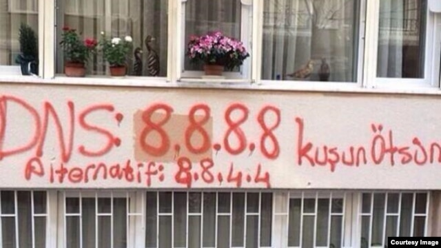 """A photo posted on Twitter apparently shows a Google DNS server spray painted into a building in Turkey. (Via <a href=""""https://twitter.com/gulayozkan/status/446959549497356288/photo/1"""">Twitter</a>)"""