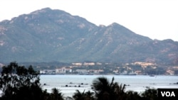 FILE - Vietnam Navy ships barely visible inside Cam Ranh Bay (D. Schearf/VOA)