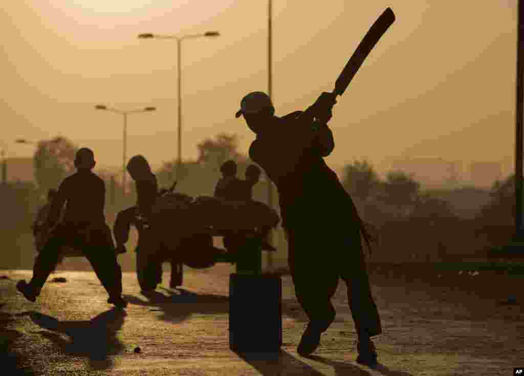 Pakistani children, who were displaced with their families from Pakistan's tribal areas due to fighting between the Taliban and the army, play cricket in a poor neighborhood on the outskirts of Islamabad, Pakistan.
