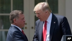 President Donald Trump and Jordan's King Abdullah II shake hands following a news conference in the Rose Garden of the White House in Washington, April 5, 2017.