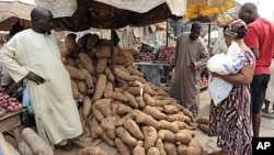 A woman shops for yams at Mile 12 market in Lagos, January 14, 2012.