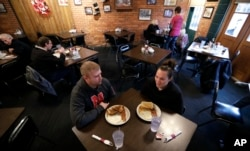 Eddie Kramer eats breakfast with his wife, Abby, at the Engine House Cafe in Lincoln, Nebraska, Jan. 4, 2017.