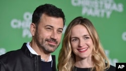 "FILE - Jimmy Kimmel, left, and Molly McNearney arrive at the Los Angeles premiere of ""Office Christmas Party"" at the Village Theatre Westwood, Dec. 7, 2016."
