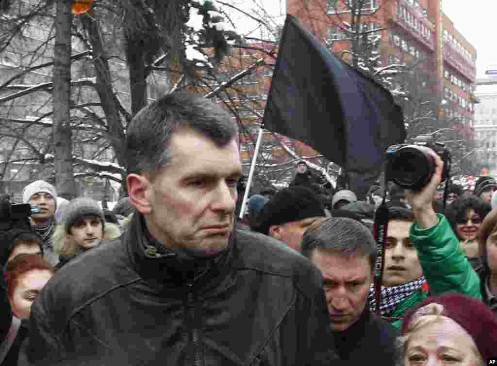 Russian tycoon Mikhail Prokhorov takes part in a demonstration against recent parliamentary election results in Moscow, December 24, 2011. (Reuters)