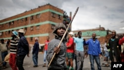 Zulu protesters demonstrate against foreign migrants outside their hostel in the Jeppestown district of Johannesburg, South Africa, April 17, 2015.