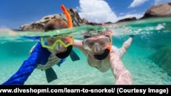 Family snorkeling in tropical water