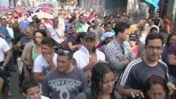 Venezuelan Voters Wait in Long Lines for Presidential Election