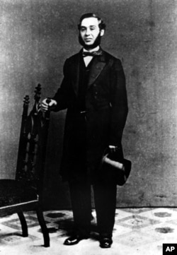 This is a 1850s photograph of Levi Strauss, who originated the denim blue jeans that bear his first name. Strauss emigrated from Bavaria with his family to New York City in 1847. In 1953 he built a clothing factory in San Francisco, supplying tough denim