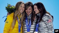 Women's snowboard halfpipe medalists, from left, Torah Bright of Australia, silver, Kaitlyn Farrington of the United States, gold, and Kelly Clark of the United States, bronze, pose with their medals at the 2014 Winter Olympics in Sochi, Feb. 13, 2014.