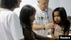 """FILE - A Kayapo girl from Gorotire tribe with symptoms of Malaria fever receives medical attention on the sixth day of a medical expedition of the """"Expedicionarios da Saude"""" (Brazilian Health Expeditions) in Kikretum community in Sao Felix, northern Brazi"""