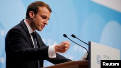 French President Emmanuel Macron speaks during the COP23 U.N. Climate Change Conference in Bonn, Germany, Nov. 15, 2017.