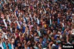 Supporters of Bilawal Bhutto Zardari, chairman of the Pakistan People's Party, wave as they listen to his speech, during a campaign rally ahead of general elections in District Thatta, Pakistan, July 2, 2018.