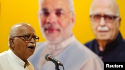 Three senior leaders of India's ruling Bharatiya Janata Party (BJP), including Lal Krishna Advani, are charged with criminal conspiracy in connection with the demolition of a 16th century mosque 25 years ago.
