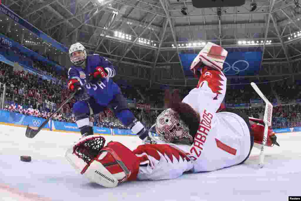 Jocelyne Lamoureux-Davidson of the U.S. scores the game winning goal against goalkeeper Shannon Szabados of Canada during a shootout in the women's gold medal hockey game in Gangneung, South Korea, Feb. 22, 2018.