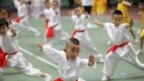 Children take part in a children's martial arts competition in Xi'an, Shaanxi province, China Ju.