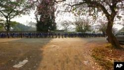 FILE: Schoolchildren queue outside their school in Zimbabwe, Monday, Sept, 28, 2020.