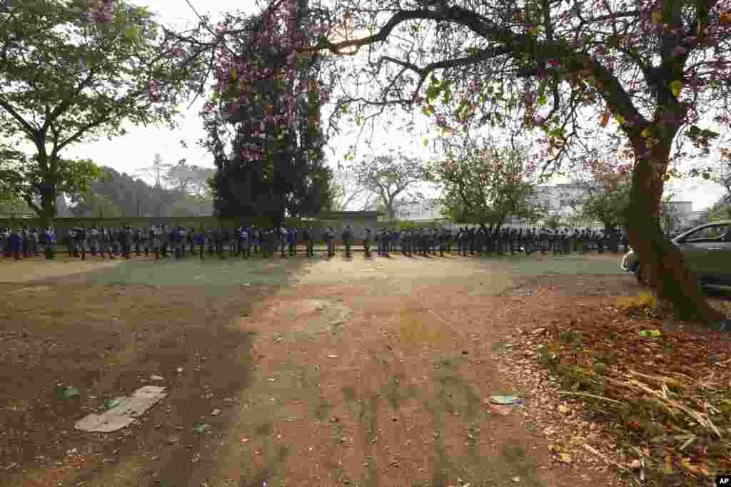 Schoolchildren queue outside their school in Harare, Zimbabwe.