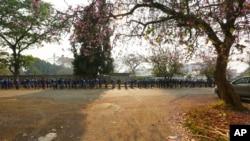 FILE: Schoolchildren queue outside their school in Harare, Zimbabwe, Monday, Sept, 28, 2020.