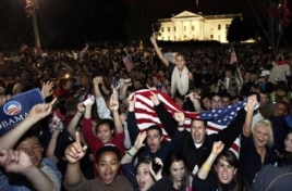 Crowds celebrate outside the White House in Washington early Monday following President Obama's televised announcement.