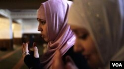 Young women pray in the Heart of Chechnya mosque during Friday Prayer.