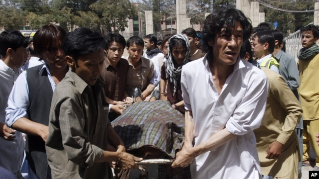 Pakistani Shiite Muslims carry the body of a person killed by gunmen at a local hospital in Quetta, Pakistan, Sept. 1, 2012.