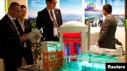 FILE - A nuclear power plant station model by China National Nuclear Corporation is pictured at the World Nuclear Exhibition 2014, the trade fair event for the global nuclear energy sector, in Le Bourget, near Paris, October 14, 2014.