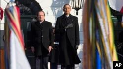 Les présidents Obama et Hollande lors de la cérémonie d'accueil à la Maison-Blanche le 11 février 2014