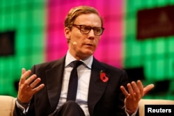 CEO of Cambridge Analytica, Alexander Nix, speaks during the Web Summit, Europe's biggest tech conference, in Lisbon, Portugal, November 9, 2017. REUTERS/Pedro Nunes