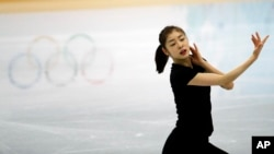 Yuna Kim of South Korea performs during the practice session at Iceberg Skating Palace at the 2014 Winter Olympics, Tuesday, Feb. 18, 2014.