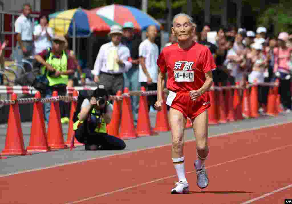 Hidekichi Miyazaki, 105, runs with other competitors over eighty years of age during a 100-meter-dash in the Kyoto Masters Autumn Competiton in Kyoto, western Japan. Miyazaki was authorized as the oldest sprinter who competed in a 100-meter-dash by the Guinness World Records.